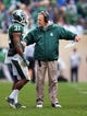 Oct 19, 2013; East Lansing, MI, USA; Michigan State Spartans head coach Mark Dantonio talks to cornerback Darqueze Dennard (31) during the 1st  half against the Purdue Boilermakers at Spartan Stadium. Mandatory Credit: Mike Carter-USA TODAY Sports
