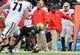 Oct 19, 2013; Nashville, TN, USA; Vanderbilt Commodores cornerback Andre Hal (23) recovers a Georgia Bulldogs fumble during the second half at Vanderbilt Stadium. The Commodores beat the Bulldogs 31-27. Mandatory Credit: Don McPeak-USA TODAY Sports