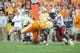 Oct 19, 2013; Knoxville, TN, USA; South Carolina Gamecocks safety Chris Moody (6) and cornerback Victor Hampton (27) tackle Tennessee Volunteers running back Marlin Lane (15) during the second half at Neyland Stadium. Tennessee won 23 to 21.  Mandatory Credit: Randy Sartin-USA TODAY Sports