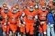 Oct 19, 2013; Stillwater, OK, USA; Oklahoma State Cowboys defensive tackle Calvin Barnett (99) leads the team onto the field before a game against the Texas Christian Horned Frogs at Boone Pickens Stadium. Oklahoma State won 24-10. Mandatory Credit: Peter G. Aiken-USA TODAY Sports