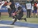 Oct 19, 2013; Buffalo, NY, USA; Buffalo Bulls running back Branden Oliver (32) runs the ball in for a touchdown during the second half against the Massachusetts Minutemen at University of Buffalo Stadium. Buffalo beats Massachusetts 32 to 3.  Mandatory Credit: Timothy T. Ludwig-USA TODAY Sports