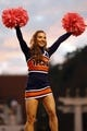 Oct 19, 2013; Charlottesville, VA, USA;  A Virginia Cavaliers cheerleader cheers during a timeout against the Duke Blue Devils in the third quarter at Scott Stadium. The Blue Devils won 35-22. Mandatory Credit: Geoff Burke-USA TODAY Sports