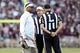 Oct 19, 2013; College Station, TX, USA; Texas A&M Aggies head coach Kevin Sumlin argues a call with line judge Terry Walters during the second half at Kyle Field. Tigers won 45-41. Mandatory Credit: Soobum Im-USA TODAY Sports