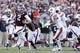 Oct 19, 2013; College Station, TX, USA; Texas A&M Aggies quarterback Johnny Manziel (2) is pursued by Auburn Tigers linebacker Cassanova McKinzy (left) during the second half at Kyle Field. Mandatory Credit: Soobum Im-USA TODAY Sports