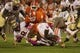 Oct 19, 2013; Clemson, SC, USA; Florida State Seminoles running back Devonta Freeman (8) is brought down during the first quarter against the Clemson Tigers at Clemson Memorial Stadium. Mandatory Credit: Joshua S. Kelly-USA TODAY Sports