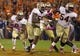 Oct 19, 2013; Clemson, SC, USA; Florida State Seminoles running back Devonta Freeman (8) carries the ball during the first half against the Clemson Tigers at Clemson Memorial Stadium. Mandatory Credit: Joshua S. Kelly-USA TODAY Sports