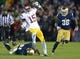 Oct 19, 2013; South Bend, IN, USA; Southern California Trojans receiver Nelson Agholor (15) is pursued by Notre Dame Fighting Irish safety Matthias Farley (41) and cornerback Cole Luke (36) at Notre Dame Stadium. Notre Dame won 14-10. Mandatory Credit: Kirby Lee-USA TODAY Sports