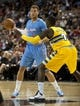 Oct 19, 2013; Las Vegas, NV, USA; Los Angeles Clippers forward Blake Griffin (32) dribbles the ball while being defended against by Denver Nuggets forward J.J. Hickson (7) during an NBA preseason game at Mandalay Bay Events Center. Mandatory Credit: Stephen R. Sylvanie-USA TODAY Sports