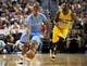 Oct 19, 2013; Las Vegas, NV, USA; Los Angeles Clippers guard Jared Dudley (9) dribbles the ball while being covered by Denver Nuggets forward Jordan Hamilton (1) during an NBA preseason game at Mandalay Bay Events Center. Mandatory Credit: Stephen R. Sylvanie-USA TODAY Sports