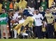 Oct 19, 2013; South Bend, IN, USA; (Editors note: Caption correction) USC Trojans wide receiver Nelson Agholor (15) loses the ball as he is hit by Notre Dame Fighting Irish cornerback KeiVarae Russell (6) and cornerback Cole Luke (36) in the fourth quarter at Notre Dame Stadium. Notre Dame won 14-10. Mandatory Credit: Matt Cashore-USA TODAY Sports