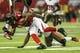 Oct 20, 2013; Atlanta, GA, USA; Atlanta Falcons wide receiver Kevin Cone (15) is tackled by Tampa Bay Buccaneers cornerback Leonard Johnson (29) in the second half at the Georgia Dome. The Falcons won 31-23. Mandatory Credit: Daniel Shirey-USA TODAY Sports