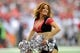 Oct 20, 2013; Atlanta, GA, USA; An Atlanta Falcons cheerleader shown performing during the game against the Tampa Bay Buccaneers during the second half at the Georgia Dome. The Falcons defeated the Buccaneers 31-23.  Mandatory Credit: Dale Zanine-USA TODAY Sports