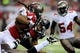 Oct 20, 2013; Atlanta, GA, USA; Atlanta Falcons running back Jacquizz Rodgers (32) is tackled by Tampa Bay Buccaneers defensive end Adrian Clayborn (94) during the second half at the Georgia Dome. The Falcons defeated the Buccaneers 31-23.  Mandatory Credit: Dale Zanine-USA TODAY Sports