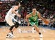 Oct 20, 2013; Montreal, Quebec, CAN; Boston Celtics guard Avery Bradley (0) dribbles past Minnesota Timberwolves guard Alexey Shved (1) during the third quarter at the Bell Centre. Mandatory Credit: Eric Bolte-USA TODAY Sports