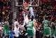 Oct 20, 2013; Montreal, Quebec, CAN; Minnesota Timberwolves center Ronny Turiaf (32) dunks over Boston Celtics center Vitor Faverani (38) during the third quarter at the Bell Centre. Mandatory Credit: Eric Bolte-USA TODAY Sports