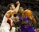 Oct 20, 2013; Portland, OR, USA; Sacramento Kings power forward Jason Thompson (34) drives to the basket over Portland Trail Blazers power forward Joel Freeland (19) in the first half at Moda Center. Mandatory Credit: Jaime Valdez-USA TODAY Sports