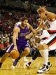 Oct 20, 2013; Portland, OR, USA; Sacramento Kings point guard Greivis Vasquez (10) dribbles around Portland Trail Blazers center Robin Lopez (42) in the first half at Moda Center. Mandatory Credit: Jaime Valdez-USA TODAY Sports