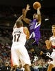 Oct 20, 2013; Portland, OR, USA; Sacramento Kings point guard Isaiah Thomas (22) shoots over Portland Trail Blazers point guard Earl Watson (17) in the first half at Moda Center. Mandatory Credit: Jaime Valdez-USA TODAY Sports