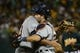October 4, 2013; Oakland, CA, USA; Detroit Tigers catcher Alex Avila (13, right) hugs relief pitcher Joaquin Benoit (53, left) after game one of the American League divisional series playoff baseball game against the Oakland Athletics at O.co Coliseum. The Tigers defeated Athletics 3-2. Mandatory Credit: Kyle Terada-USA TODAY Sports