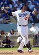 October 16, 2013; Los Angeles, CA, USA;  Los Angeles Dodgers first baseman Adrian Gonzalez (23) hits a solo home run in the third inning  during game five of the National League Championship Series against the St. Louis Cardinals at Dodger Stadium. Mandatory Credit: Jayne Kamin-Oncea-USA TODAY Sports