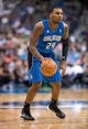 Oct 14, 2013; Dallas, TX, USA; Orlando Magic small forward Romero Osby (24) looks to pass the ball during the game against the Dallas Mavericks at the American Airlines Center. The Magic defeated the Mavericks 102-94. Mandatory Credit: Jerome Miron-USA TODAY Sports