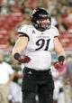 Oct 5, 2013; Tampa, FL, USA; Cincinnati Bearcats defensive tackle Adam Dempsey (91) reacts after he sacked South Florida Bulls quarterback Bobby Eveld (13) (not pictured) during the second half at Raymond James Stadium. South Florida Bulls defeated the Cincinnati Bearcats 26-20. Mandatory Credit: Kim Klement-USA TODAY Sports
