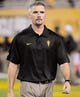 Oct 12, 2013; Tempe, AZ, USA; Arizona State Sun Devils offensive coordinator Mike Norvell watches warm ups before the first quarter against the Colorado Buffaloes at Sun Devil Stadium. The Sun Devils beat the Buffaloes 54-13. Mandatory Credit: Casey Sapio-USA TODAY Sports