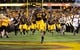 Oct 12, 2013; Tempe, AZ, USA; Arizona State Sun Devils wide receiver Kevin Ozier (82) runs onto the field before the first quarter against the Colorado Buffaloes at Sun Devil Stadium. The Sun Devils beat the Buffaloes 54-13. Mandatory Credit: Casey Sapio-USA TODAY Sports