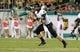 Oct 5, 2013; Tampa, FL, USA; Cincinnati Bearcats quarterback Brendon Kay (11) runs out of the pocket during the first quarter against the South Florida Bulls at Raymond James Stadium. Mandatory Credit: Kim Klement-USA TODAY Sports