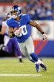 Oct 21, 2013; East Rutherford, NJ, USA; New York Giants wide receiver Victor Cruz (80) runs after making a catch against the Minnesota Vikings during the first half at MetLife Stadium. The Giants won the game 23-7. Mandatory Credit: Joe Camporeale-USA TODAY Sports