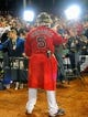 Oct 19, 2013; Boston, MA, USA; Boston Red Sox left fielder Jonny Gomes (5) gets ready for an interview after defeating the Detroit Tigers in game six of the American League Championship Series baseball game at Fenway Park. Mandatory Credit: Bob DeChiara-USA TODAY Sports