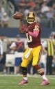 Oct 13, 2013; Arlington, TX, USA; Washington Redskins quarterback Robert Griffin III (10) throws in the pocket against the Dallas Cowboys at AT&T Stadium. Mandatory Credit: Matthew Emmons-USA TODAY Sports