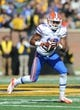Oct 19, 2013; Columbia, MO, USA; Florida Gators running back Valdez Showers (10) catches a pass during the second half of the game against the Missouri Tigers at Faurot Field. Missouri won 36-17. Mandatory Credit: Denny Medley-USA TODAY Sports