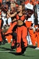 Oct 19, 2013; Stillwater, OK, USA; A member of the Oklahoma State Cowboys dance team performs before a game against the Texas Christian Horned Frogs at Boone Pickens Stadium. Mandatory Credit: Peter G. Aiken-USA TODAY Sports