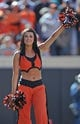 Oct 19, 2013; Stillwater, OK, USA; A member of the Oklahoma State Cowboys dance team performs during a game against the Texas Christian Horned Frogs at Boone Pickens Stadium. Mandatory Credit: Peter G. Aiken-USA TODAY Sports