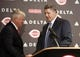 Oct 22, 2013; Cincinnati, OH, USA; Cincinnati Reds new manager Bryan Price (right) shakes hands with general manager Walt Jocketty as he is introduced during a news conference at Great American Ballpark. Mandatory Credit: David Kohl-USA TODAY Sports