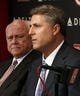 Oct 22, 2013; Cincinnati, OH, USA; Cincinnati Reds new manager Bryan Price (right) speaks as general manager Walt Jocketty listens during a news conference at Great American Ballpark. Mandatory Credit: David Kohl-USA TODAY Sports