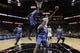 Oct 22, 2013; San Antonio, TX, USA; San Antonio Spurs forward Kawhi Leonard (2) drives to the basket under pressure from Orlando Magic forward Solomon Jones (22) during the first half at AT&T Center. Mandatory Credit: Soobum Im-USA TODAY Sports