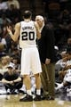 Oct 22, 2013; San Antonio, TX, USA; San Antonio Spurs guard Manu Ginobili (20) talks with head coach Gregg Popovich during the second half against the Orlando Magic at AT&T Center. Mandatory Credit: Soobum Im-USA TODAY Sports