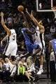 Oct 22, 2013; San Antonio, TX, USA; Orlando Magic guard Victor Oladipo (5) drives to the basket as San Antonio Spurs forward Jeff Ayres (11) defends during the second half at AT&T Center. Mandatory Credit: Soobum Im-USA TODAY Sports