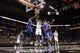 Oct 22, 2013; San Antonio, TX, USA; San Antonio Spurs forward Tim Duncan (21) shoots while Orlando Magic forward Jason Maxiell (left) and  Solomon Jones (right) defend during the second half at AT&T Center. The Spurs won 123-101. Mandatory Credit: Soobum Im-USA TODAY Sports