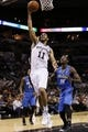 Oct 22, 2013; San Antonio, TX, USA; San Antonio Spurs forward Jeff Ayres (11) drives to the basket as Orlando Magic forward Andrew Nicholson (44) looks on during the second half at AT&T Center. The Spurs won 123-101. Mandatory Credit: Soobum Im-USA TODAY Sports