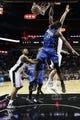 Oct 22, 2013; San Antonio, TX, USA; Orlando Magic forward Maurice Harkless (21) dunks past San Antonio Spurs forward Aron Baynes (behind) during the second half at AT&T Center. The Spurs won 123-101. Mandatory Credit: Soobum Im-USA TODAY Sports