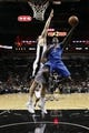 Oct 22, 2013; San Antonio, TX, USA; Orlando Magic guard Victor Oladipo (5) drives to the basket as San Antonio Spurs forward Aron Baynes (16) defends during the second half at AT&T Center. The Spurs won 123-101. Mandatory Credit: Soobum Im-USA TODAY Sports