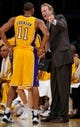 Oct 22, 2013; Los Angeles, CA, USA;  Laker assistant coach Kurt Rambis talks to Los Angeles Lakers shooting guard Wesley Johnson (11) during the second half of the Lakers' game against the Utah Jazz at Staples Center. Mandatory Credit: Robert Hanashiro-USA TODAY Sports