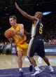 Oct 22, 2013; Los Angeles, CA, USA; Los Angeles Lakers point guard Steve Nash (10) looks for a teammate to pass of to as Utah Jazz point guard John Lucas III (5) defend during second quarter action at Staples Center. Mandatory Credit: Robert Hanashiro-USA TODAY Sports