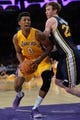 Oct 22, 2013; Los Angeles, CA, USA; Los Angeles Lakers shooting guard Nick Young (0) drives to the basket on Utah Jazz small forward Gordon Hayward (20) during second quarter action at Staples Center. Mandatory Credit: Robert Hanashiro-USA TODAY Sports