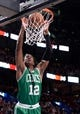 Oct 20, 2013; Montreal, Quebec, CAN; Boston Celtics guard MarShon Brooks (12) dunks during the third quarter against the Minnesota Timberwolves at the Bell Centre. Mandatory Credit: Eric Bolte-USA TODAY Sports