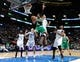 Oct 20, 2013; Montreal, Quebec, CAN; Boston Celtics guard MarShon Brooks (12) goes up while Minnesota Timberwolves center Chris Johnson (3) defends during the third quarter at the Bell Centre. Mandatory Credit: Eric Bolte-USA TODAY Sports