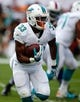 Oct 20, 2013; Miami Gardens, FL, USA;  Miami Dolphins running back Daniel Thomas (33) runs with the ball in the first quarter of a game against the Buffalo Bills at Sun Life Stadium. Mandatory Credit: Robert Mayer-USA TODAY Sports